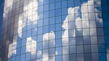 sky with clouds reflected on building